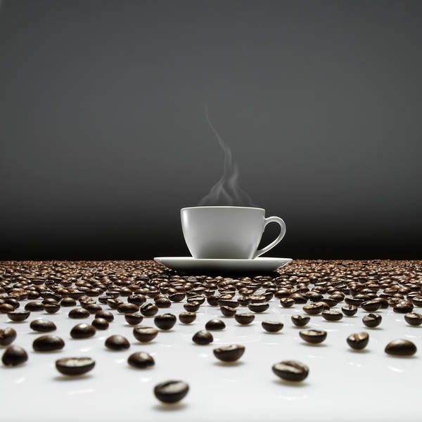 Coffee Photograph - A Cup Of Coffee Sitting In The Middle by Jostaphot