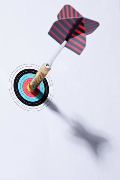 Archery Photograph - A Dart Stuck In The Bulls Eye Of A by Larry Washburn