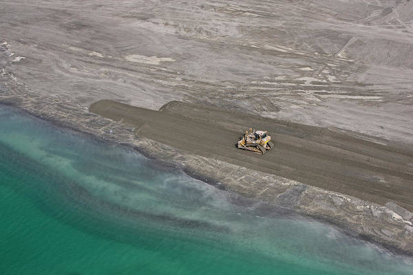 Land Mark Photograph - A Digger Moves Sand In Abu Dhabi by Mark Brown