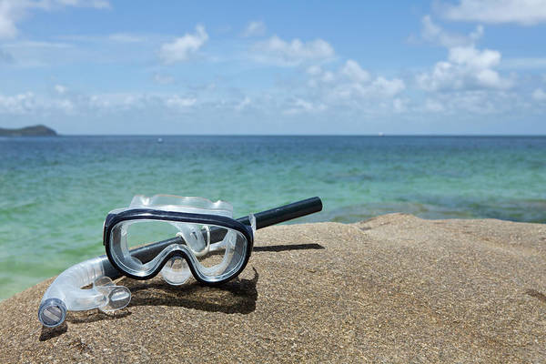 Waters Edge Wall Art - Photograph - A Diving Mask And Snorkel On A Rock by Caspar Benson