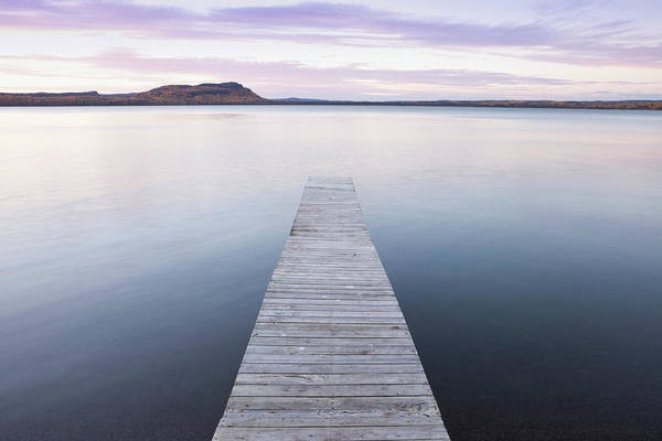 Lake Superior Photograph - A Dock In Lake Superior At Sunset by Susan Dykstra / Design Pics