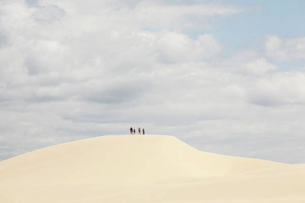 Oregon Dunes Photograph - A Family Hikes Across The Dunes At by Win-initiative