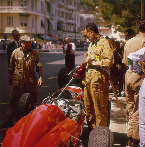 Filling Photograph - A Ferrari Team Member Filling A Car by Heritage Images