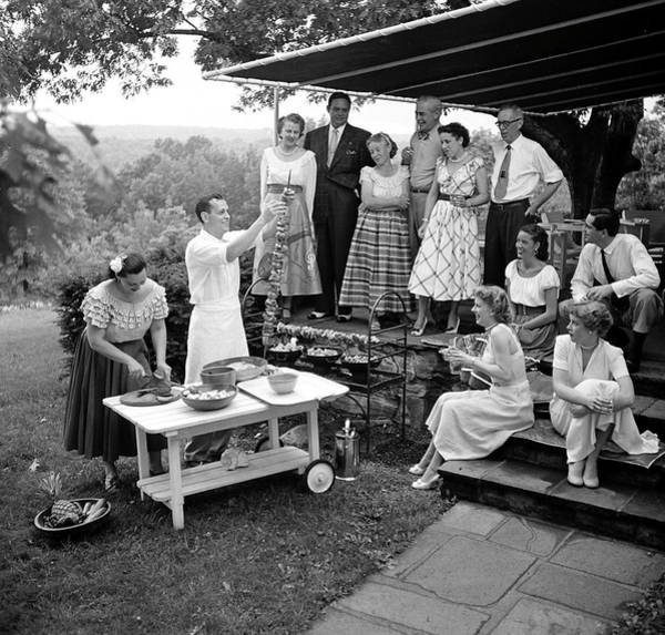 Guest Photograph - A Gathering Of Well Dressed Guests At A by Nina Leen