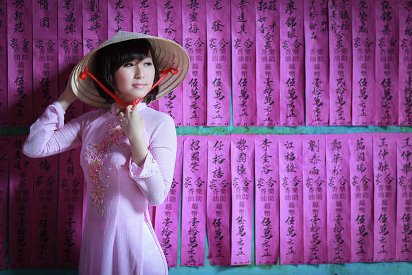 Bangs Photograph - A Girl In A Pink Ao Dai And A Non La by Jethuynh