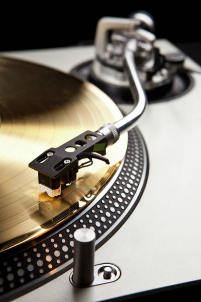 Black Background Photograph - A Gold Record On A Turntable by Caspar Benson