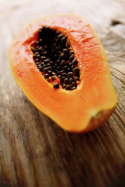 Fruit Photograph - A Halved Fresh Papaya On A Wooden by Chang