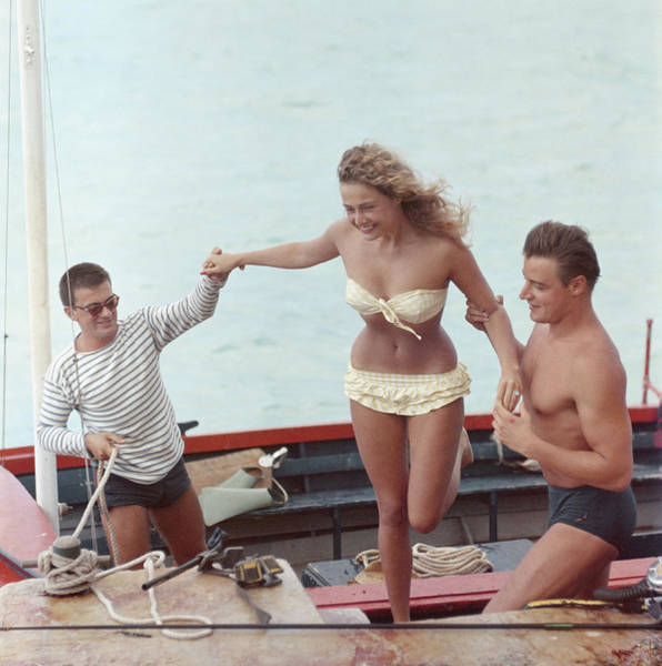 Human Interest Photograph - A Helping Hand by Slim Aarons