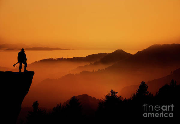 Wall Art - Photograph - A Hunter Standing On Top Of A Cliff by Bahram Pourshahbazi