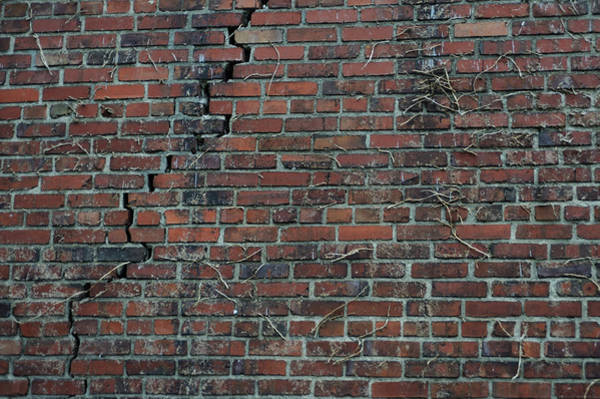 Damaged Photograph - A Large Crack In Brick Wall by Aaron Mccoy