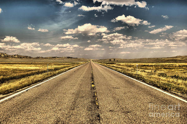 Wall Art - Photograph - A Long Straight Road And A Fast Fast Car by Jeff Swan