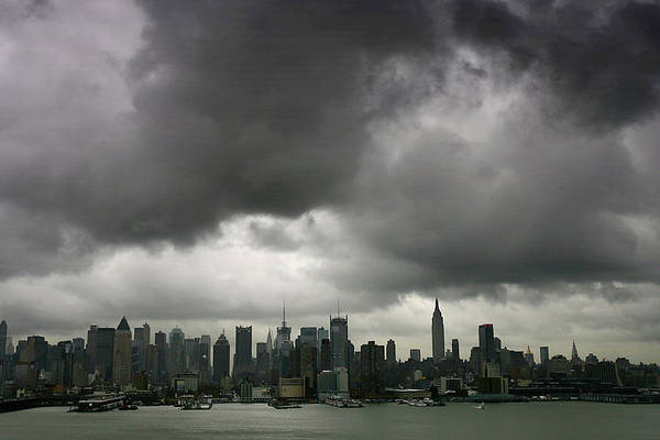 Wall Art - Photograph - A Low Layer Of Dark Clouds Hangs Over by New York Daily News Archive