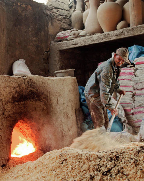 Workshop Photograph - A Man Fuelling A Kiln, Used For Firing by Cultura Rm Exclusive/philip Lee Harvey