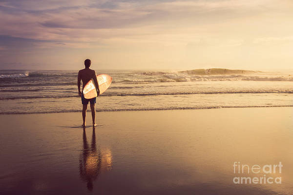 Wall Art - Photograph - A Man Is Standing With A Surf In His by Mariia Smeshkova