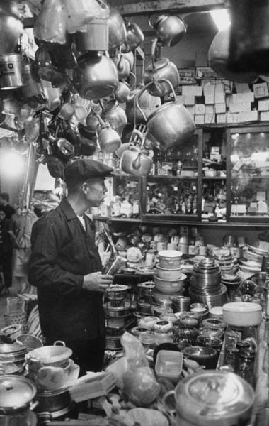 Merchandise Photograph - A Man Shopping In A Store.  Photo By Jo by John Dominis