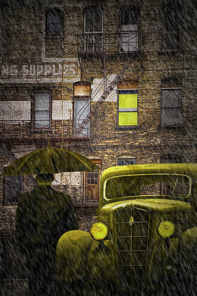 Photograph - A Man Standing In The Rain With An Umbrella Waiting Along Side A Vintage Auto by Randall Nyhof