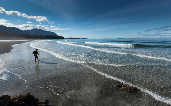 Vancouver Island Photograph - A Man Walks Along The Sandy Beach Of by Debra Brash / Design Pics