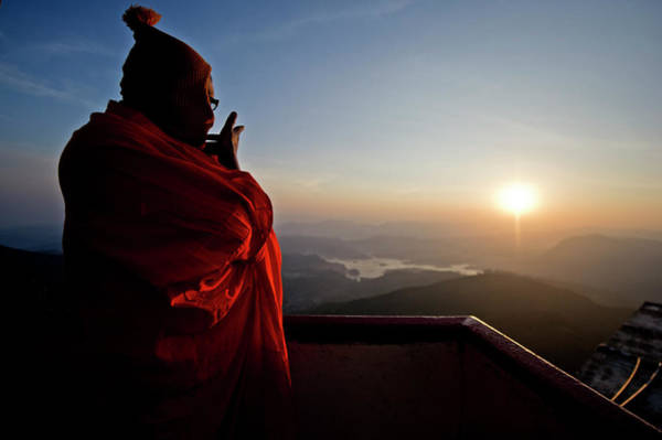 Real People Photograph - A Monk Looks Out Over A Sunrise From by James Morgan / Robertharding