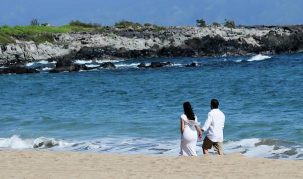 Hawaiiana Photograph - A Newlywed Couple Hold Hands Walking Dt Fleming Beach Park, West by Derrick Neill