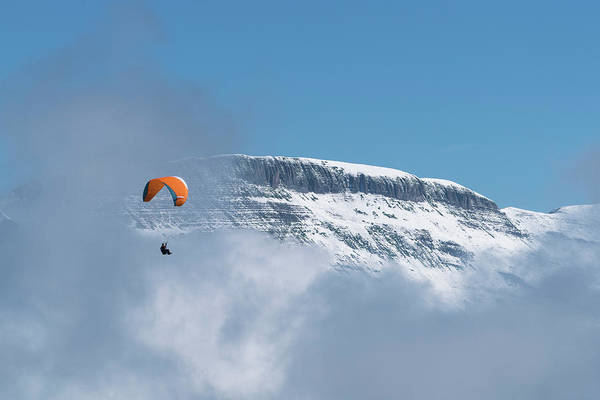 Wall Art - Photograph - A Parasailer Floats Above The Clouds by Brenda Tharp