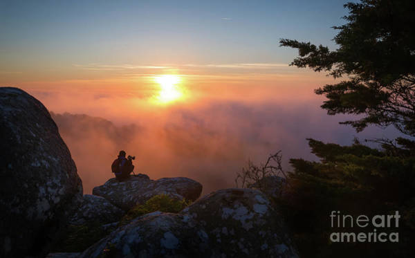 Wall Art - Photograph - A Photographer Sitting On A High Rock by Jorge Veloso