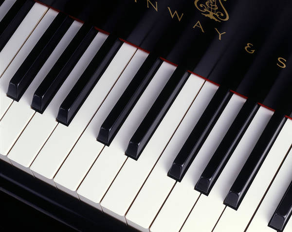 Piano Photograph - A Piano Keyboard Is Viewed From Above by John T. Wong