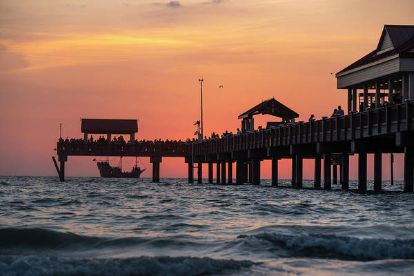 Photograph - A Pirate Ship Sales Past The Clearwater Pier At Sunset Florida by Toby McGuire