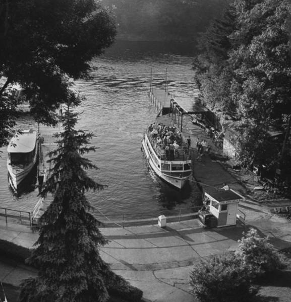 Wall Art - Photograph - A Pleasure Boat At Dock In The Deep Fore by Francis Miller