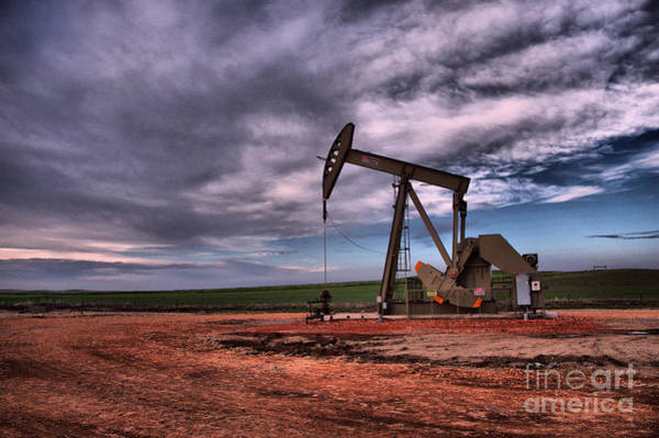 Wall Art - Photograph - A Pump Jack In The Clouds by Jeff Swan