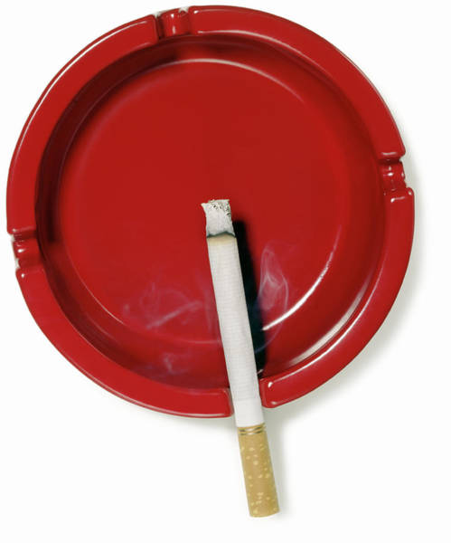 No Smoking Wall Art - Photograph - A Red Ashtray With A Burning Cigarette by Steve Wisbauer