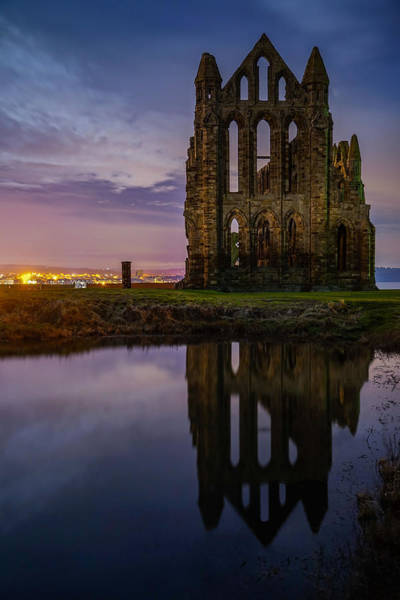Wall Art - Photograph - A Reflection Of Whitby Abbey In England Seen On A Beautiful Night. by George Afostovremea
