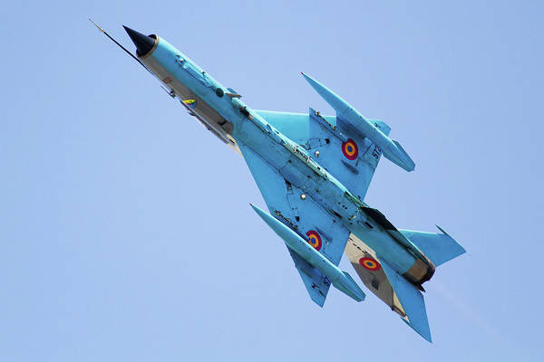 Sunny Side Up Wall Art - Photograph - A Romanian Air Force Mig-21 Mf Lancer-c by Anton Balakchiev/stocktrek Images