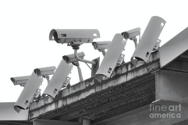 Wall Art - Photograph - A Row Of Security Cameras by Yali Shi
