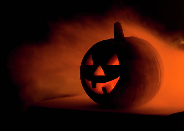 Human Face Photograph - A Scary Halloween Pumpkin In Smoke by Ilonabudzbon