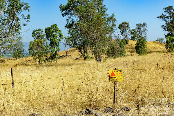 Photograph - A Sign Warns Of Uncleared Mines In The Golan Heights, Israel. A  by William Kuta