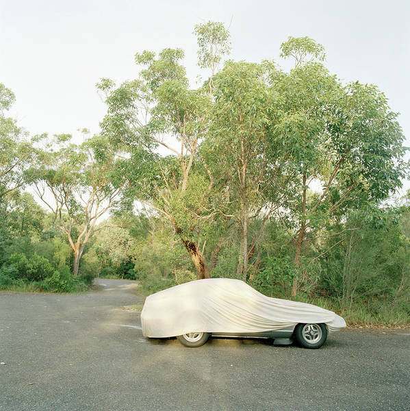 Hiding Photograph - A Sports Car Covered With A Tarp by Julia Christe