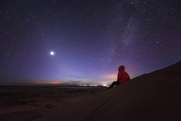 Wall Art - Photograph - A Stargazer Sitting In The Evening by Jeff Dai