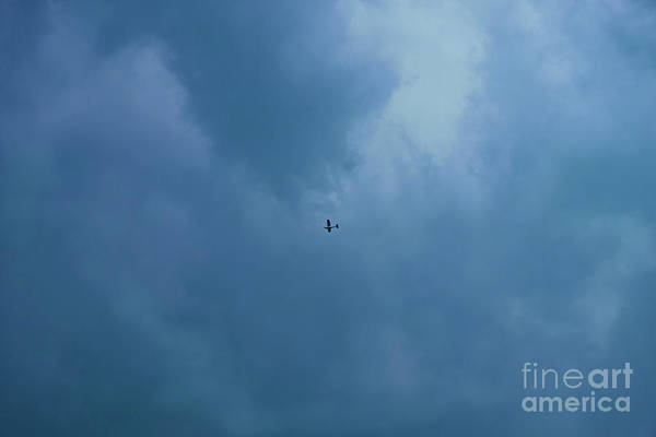 Photograph - A Stormy Sky And A Little Plane by Marina Usmanskaya