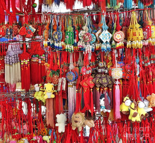 Photograph - A Street Vendor Sells Scented Sachets by Yali Shi
