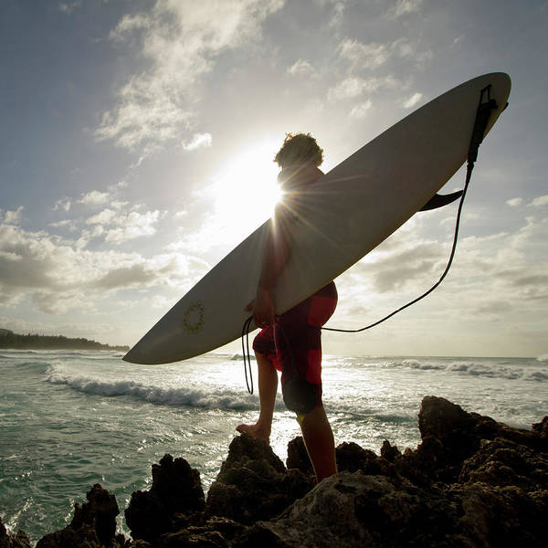 Real People Photograph - A Surfer Stands On A Rock And Looks At by Noel Hendrickson