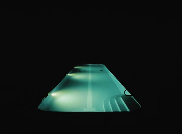 Underwater Scene Photograph - A Swimming Pool Lit At Night by Frederick Bass