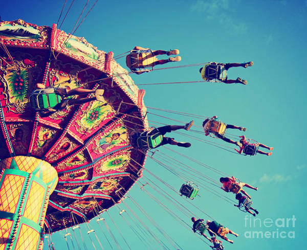 Wall Art - Photograph - A Swinging Fair Ride At Dusk Toned With by Annette Shaff