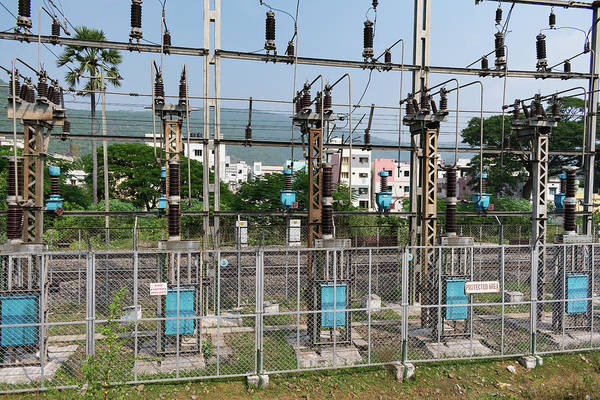Isolator Wall Art - Photograph - A Transformer Yard Close View With Background City Building. by Kumud Bagh
