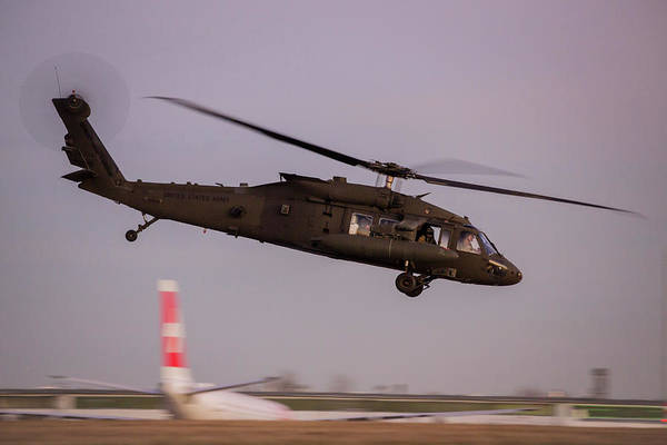 Wall Art - Photograph - A Uh-60m Black Hawk Helicopter Of U.s by Timm Ziegenthaler