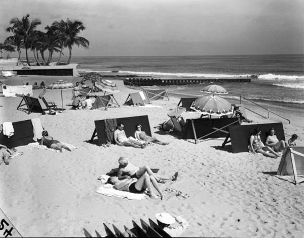 A View Of Sunbathers Lying On A Beach Art Print
