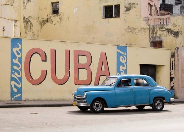 West Indies Wall Art - Photograph - A Vintage 1950s American Car Passing A by Ellen Rooney / Robertharding