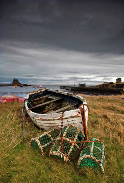 Sport Fishing Photograph - A Weathered Boat And Fishing Equipment by John Short / Design Pics