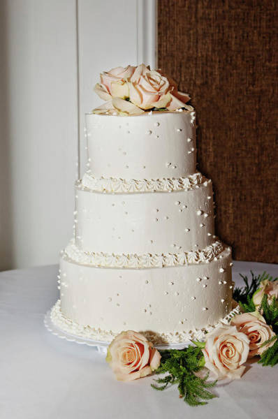 May Day Photograph - A Wedding Cake Trimed In Peach Roses by Driendl Group