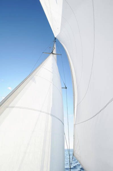 Rigging Photograph - A White Sail Being Blown By The Wind by Nikitje