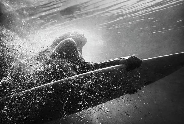 Bikini Photograph - A Woman On A Surfboard Under The Water by Ben Welsh / Design Pics